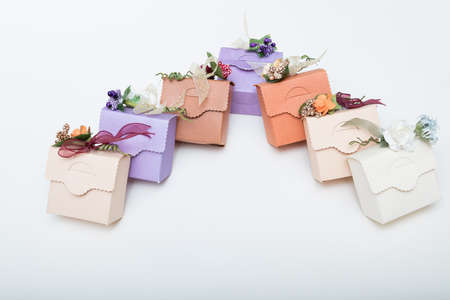 Light colours gift boxes  with flowes and ribbons, on white background copy spaces for text Stock Photo