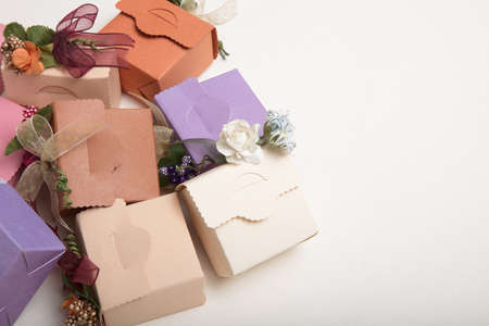 Fancy  carton wedding or  gift boxes with ribbon and flowers with copy spaces , high quality image Stock Photo