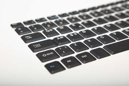 Low angle view of a computer keyboard with selective focus to the left side with copy space