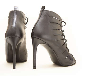 Rear view of elegant expensive black high heel women shoes on a white background with copy space Banque d'images
