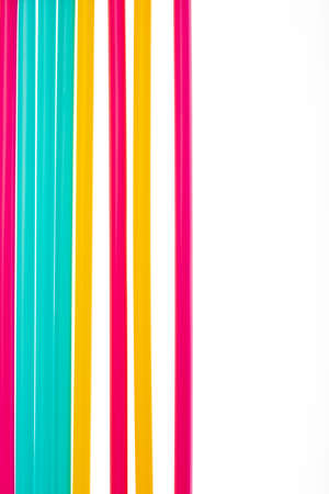 Fancy straw art background. Abstract wallpaper of colored fancy straws. Rainbow colored colorful pattern texture with  copy space Stock Photo