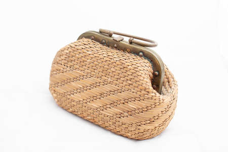 Fashionable stylish rattan bag isolated on white background