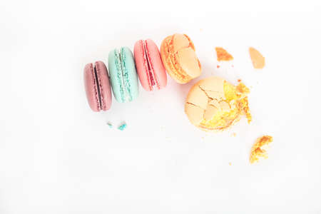 Colorful macarons cakes. Small French cakes. Sweet and colorful french macaroons on white background,high angle view  with Stock Photo