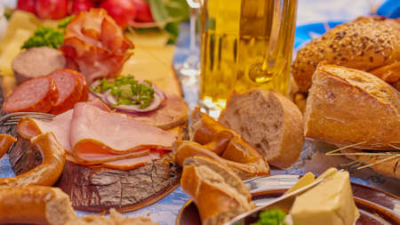 Sausage plate with beer, ham, butter and pretzels and bread