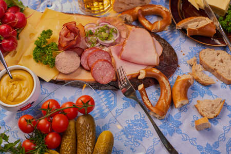 Snack Bavarian traditional Oktoberfest various sausages and beer with bread