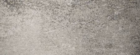 Bright fine-grained sandy texture, natural structure.Facing stone texture.sand fine crumb brown tone texture background.