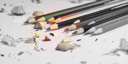 Various Color of Wooden Pencils and Shavings Top Corner View on a Pure White Background.Sorted Colorful Pencils with Selective Focus on Subject.Blurry Background Heap of Colorful Pencils with Copy Space For Text .