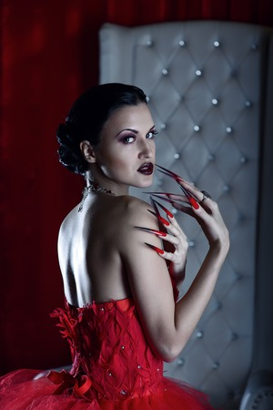 femme fatale: femme fatale vamp in red dress and the white throne