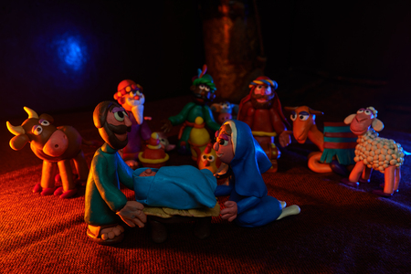 many plasticine figures on the theme of Christmas with beautiful lighting