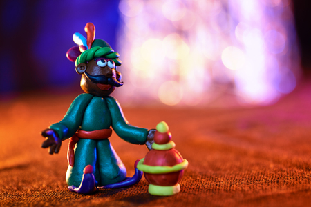 the sorcerer and the box with gifts for Christmas on blurred background Фото со стока - 115778929