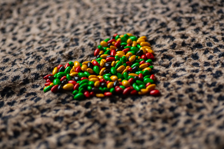 the heart sign is lined with colorful candies on leopard skin