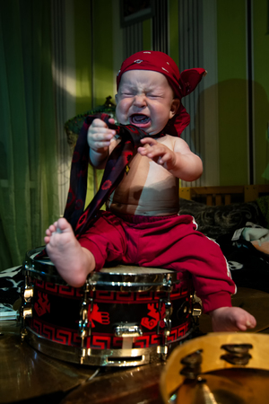 little boy rocker drummer in red bandana and with drum