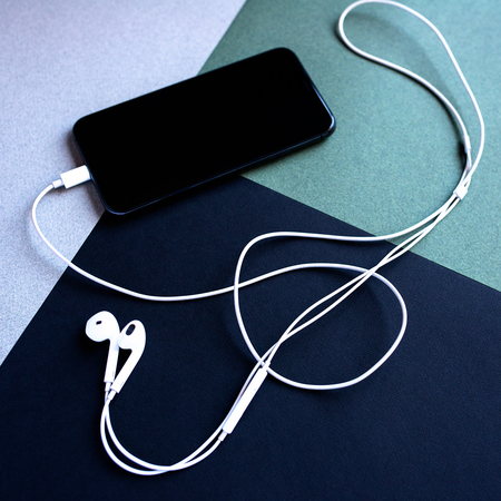 mobile phone with headphones in the shape of a violin key