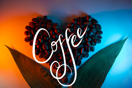 coffee beans are highlighted with colored neon lined in the shape of a heart and leaves