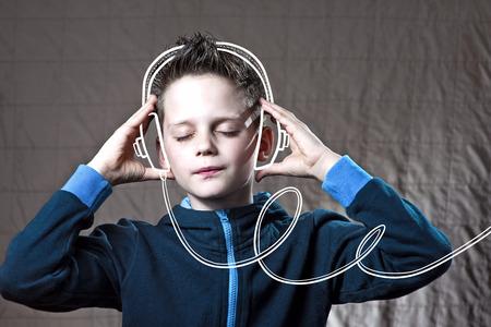 boy listening to music Doodle headphones and enjoy Stock Photo