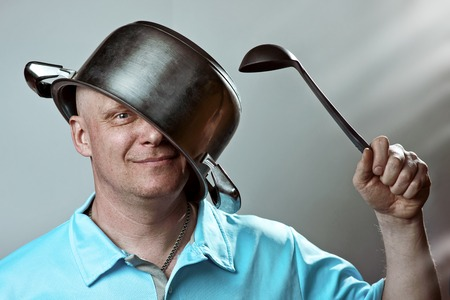 bald brutal man with a pot on his head and a ladle in his hand