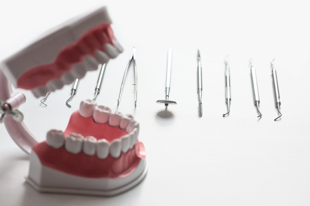 various dental tools laid out flatlay on a light background Stock Photo - 124748609