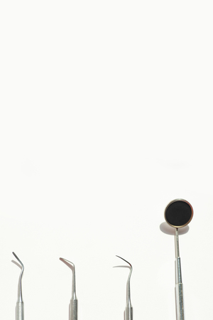 a various dental tools laid out flatlay on a light background Stock Photo - 124752580