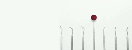 a various dental tools laid out flatlay on a light background Stock Photo - 124752583
