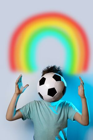 being in a soccer ball instead of a head on a blue background and rainbow