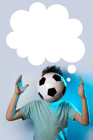 being in a soccer ball instead of a head on a blue background and cloud Stockfoto - 125043785