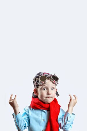 rocker boy in blue shirt, red scarf, biker glasses and bandana on light background Archivio Fotografico