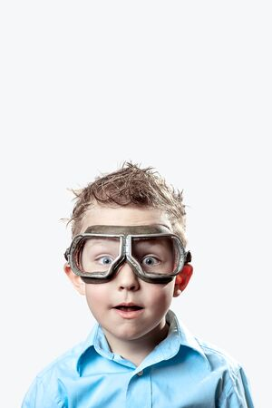 boy in blue shirt and pilot glasses on a light background