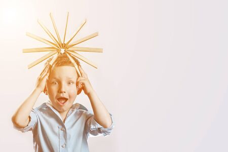 surprised boy in a blue shirt and drive on her head on bright background Stok Fotoğraf
