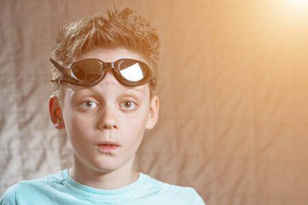 surprised teen boy in black swimming glasses Stock Photo