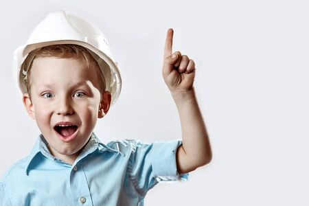 the boy in the light blue shirt and construction helmet of the foreman raised a finger, as if he had found the idea