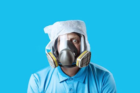 a man in a gas mask and a plastic bag on his head symbolizes the protection of the environment from pollution on a blue background
