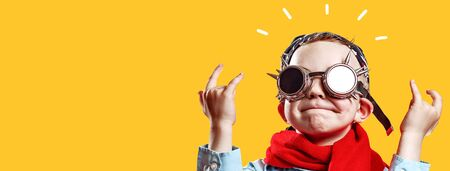 boy in blue shirt, red scarf, biker glasses and bandana on bright background