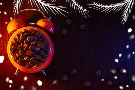 winter orange alarm clock with coffee beans on a dark wooden table