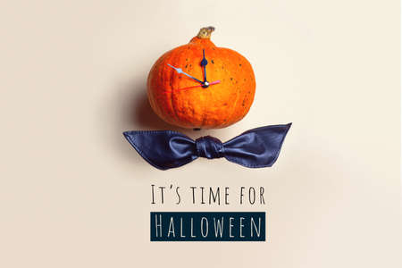 Pumpkin clock shows the time before Halloween. Concept