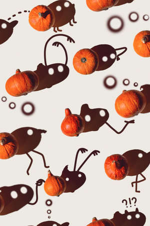 Pattern of many different pumpkins with a hard shadow on a gray background. Halloween concept 스톡 콘텐츠 - 154541536