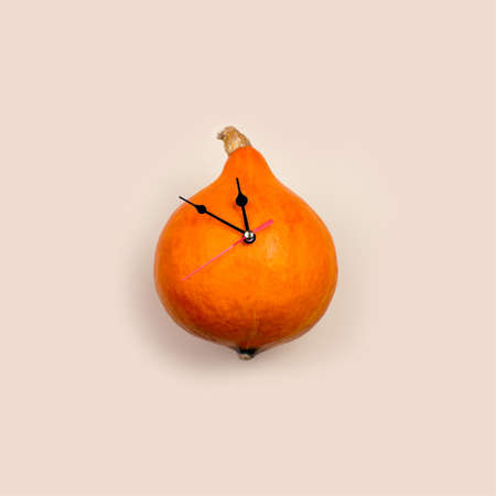 Pumpkin clock shows the time before Halloween. Concept.