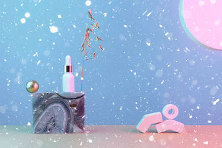 Oil restoring serum with gold, anti-aging facial care, still life with marble, sun, snow, wheat and geometric shapes, the concept of beauty. 版權商用圖片