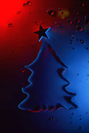 New year and christmas tree made of water with star illuminated by neon, festive concept 스톡 콘텐츠