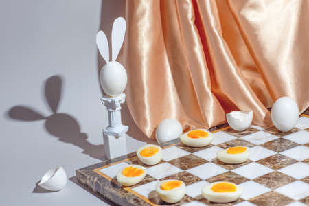 Easter chess play with fresh and boiled eggs