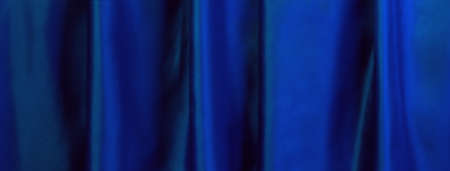 Blue curtain for background with space for text.