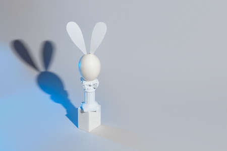Easter bunny of eggs and columns on a gray background.