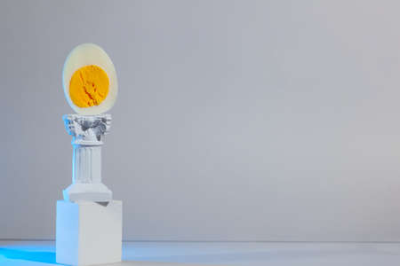 Monumental egg on the column and podium, The Easter concept 스톡 콘텐츠