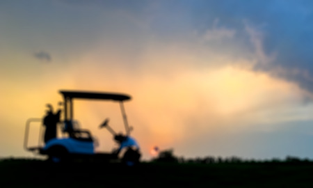 ilhouette golf cart in golf course with colorful twilight sky on sunset soft cloud for background backdrop use
