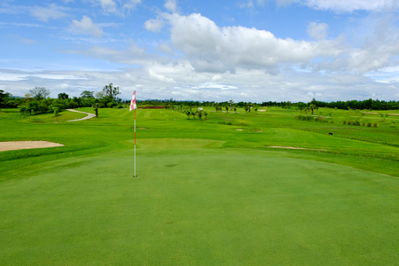 Green fairway and blue sky in Golf course
