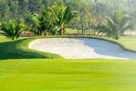 Beautiful fairway  sand bunkers and lake  in the golf course  northern of Thailand with sky background Reklamní fotografie