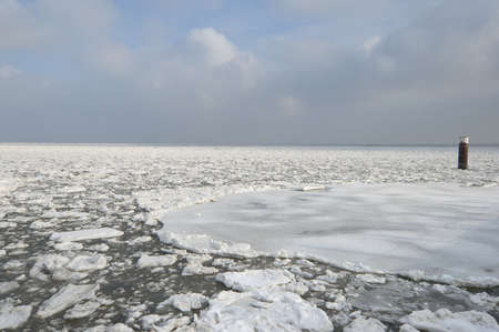 The North Sea with ice floes on the Iceland of Sylt photo