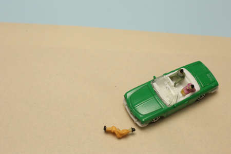 miniature people sitting on car and road rage accident Reklamní fotografie