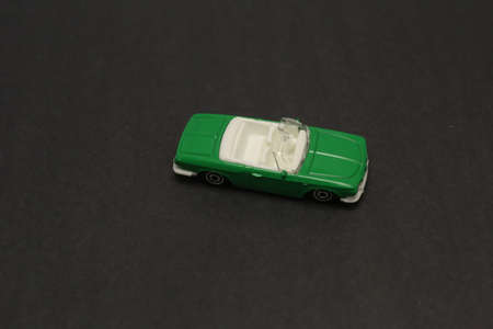 green miniature car on the grey background Stok Fotoğraf