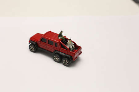 Miniature people on car sitting together Stok Fotoğraf