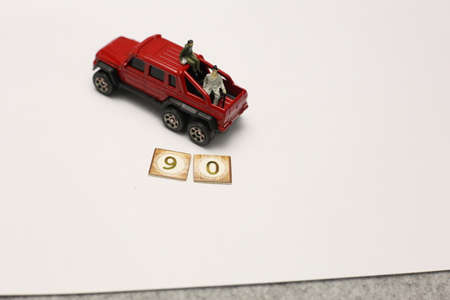 Miniature people on car sitting together celebrating new year